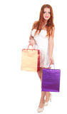 Beautiful woman with red hairs holding shopping bags Royalty Free Stock Photography