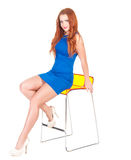 Beautiful woman with red hairs sitting on bar chair Stock Photo