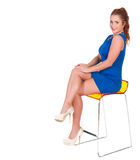 Beautiful woman with red hairs sitting on bar chair Royalty Free Stock Photography