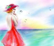 Beautiful woman in red hat and a dress on the river. summer Royalty Free Stock Photos