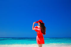 Beautiful woman with red hat enjoying on tropical beach, fashion Royalty Free Stock Photos
