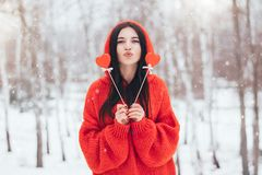 Beautiful woman with red hearts for Valentine`s Day on winter background royalty free stock photography