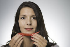 Beautiful woman with a red hot chilli pepper Stock Photography