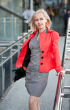 Beautiful woman in red jacket Stock Photos