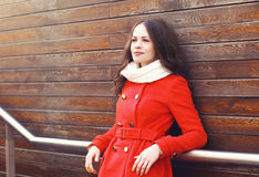 Beautiful woman in red jacket outdoors Stock Image