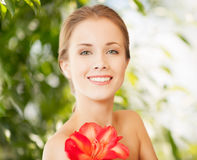 Beautiful woman with red lily flower Stock Photo