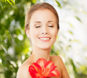 Beautiful woman with red lily flower Royalty Free Stock Photography