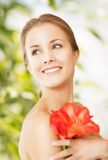 Beautiful woman with red lily flower Stock Images