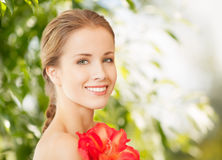 Beautiful woman with red lily flower Royalty Free Stock Photo