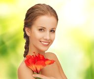 Beautiful woman with red lily flower Royalty Free Stock Photos