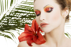 Beautiful woman with a red lily Royalty Free Stock Photos
