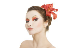 Beautiful woman with a red lily Royalty Free Stock Photo