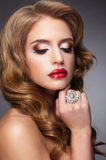 Beautiful woman with red lips ang long lashes Royalty Free Stock Images