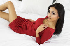 Beautiful woman in red with long dark hair Stock Photography