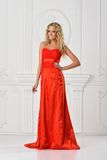 Beautiful woman in red long dress. Royalty Free Stock Images