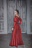 Beautiful woman in red medieval dress Stock Photography