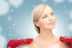 Beautiful woman in red mittens Stock Image