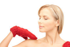 Beautiful woman in red mittens Stock Images