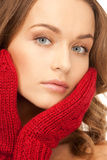 Beautiful woman in red mittens Royalty Free Stock Photo