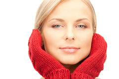 Beautiful woman in red mittens Stock Photo