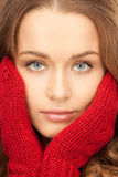 Beautiful woman in red mittens Royalty Free Stock Photos
