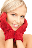 Beautiful woman in red mittens Royalty Free Stock Photography