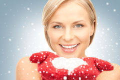 beautiful woman in red mittens with snow Royalty Free Stock Photo