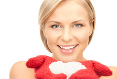 Beautiful woman in red mittens with snow Royalty Free Stock Photos