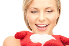 Beautiful woman in red mittens with snow Stock Images