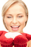 Beautiful woman in red mittens with snow Stock Photo