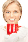 Beautiful woman with red mug Stock Image
