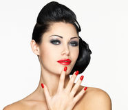 Beautiful woman with red nails and fashion makeup Stock Images