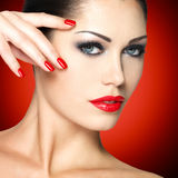 Beautiful woman with red nails Stock Photos
