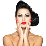 Beautiful woman with red nails and fashion makeup Royalty Free Stock Images
