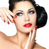 Beautiful woman with red nails and fashion makeup Royalty Free Stock Photo
