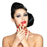 Beautiful woman with red nails and fashion makeup Stock Photography