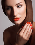 Beautiful Woman With Red Nails. Makeup and Manicure. Red Lips Stock Photo