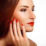 Beautiful Woman With Red Nails. Makeup and Manicure. Red Lips Stock Photography
