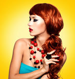 Beautiful woman with red nails and red hairs Royalty Free Stock Photography