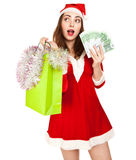 Beautiful woman in red new year costume with a lot of euros Royalty Free Stock Images