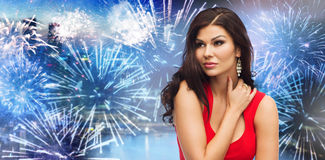 Beautiful woman in red over firework at night city Royalty Free Stock Photo
