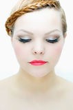 Beautiful woman with red plaited hairstyle, pale skin and smokey eye make-up. Stock Image