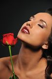 beautiful woman with a red rose Stock Photos