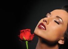 Beautiful woman with a red rose Royalty Free Stock Photography