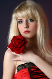 Beautiful woman with red rose Stock Photo