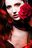 Beautiful woman with red rose Stock Image