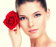 Beautiful woman with a red rose. Royalty Free Stock Photography