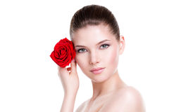 Beautiful woman with a red rose. Portrait of pretty face of beautiful woman with a red rose - isolated on white royalty free stock photo