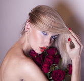 Beautiful woman with red roses. Royalty Free Stock Photography