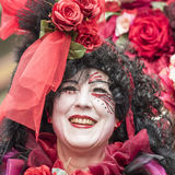 Beautiful woman in red roses, carnival Zurich stock photos